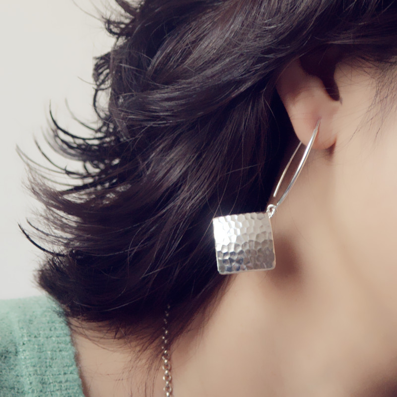 girl with sterling silver earring